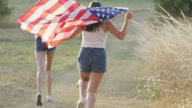 girls running with an american flag - fourth of july stock videos & royalty-free footage