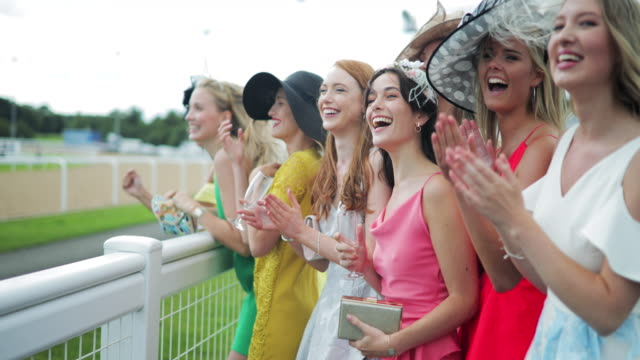 girls screaming for their horse on ladies day - horse racing stock videos & royalty-free footage