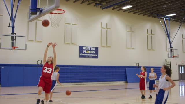 girls shooting layups during basketball practice - basketball sport stock videos & royalty-free footage