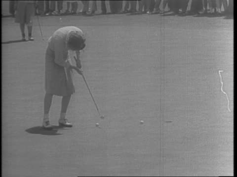 girls signing up with wacs, waves, spars, marines / female golfers, patty berg and dorothy kirby, on the golf course / patty berg receives cup from... - sportlerin stock-videos und b-roll-filmmaterial