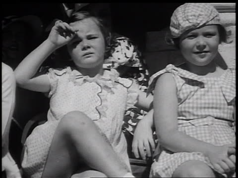 stockvideo's en b-roll-footage met pan 2 girls sitting in children's fashion show outdoors / miami florida / newsreel - alleen meisjes