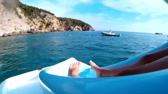 Girls sliding from pedal boat