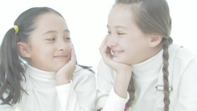 Girls smiling at each other