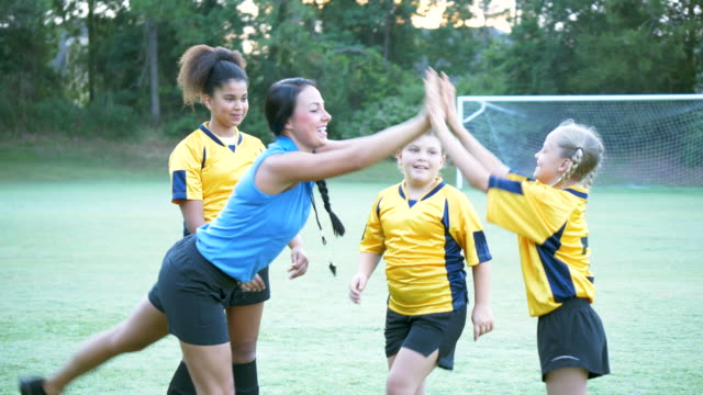 girls soccer coach giving players high fives - 10 11 years stock videos & royalty-free footage
