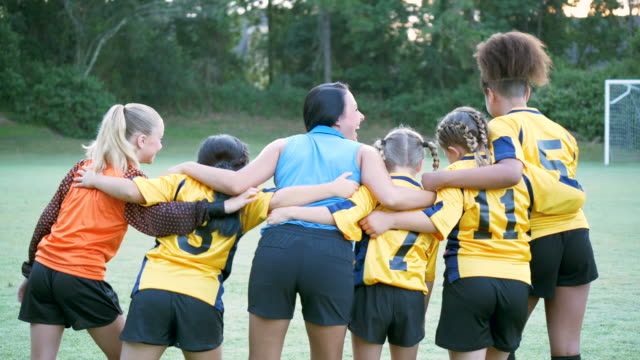 girl's soccer team and coach gathering together - three quarter length stock videos & royalty-free footage