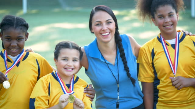 girl's soccer team and coach, showing off their medals - 10 11 years stock videos & royalty-free footage