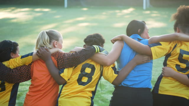 girl's soccer team and coach standing together - 10 11 years stock videos & royalty-free footage