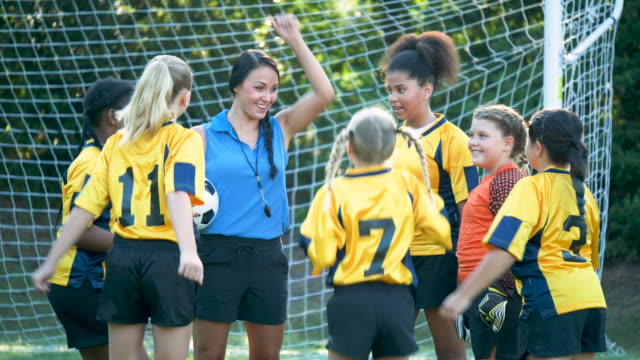 girl's soccer team, pep talk from the coach - 25 29 years stock videos & royalty-free footage