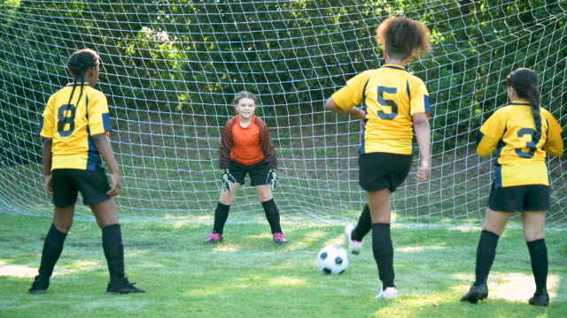 girl's soccer team practicing - soccer uniform stock videos & royalty-free footage