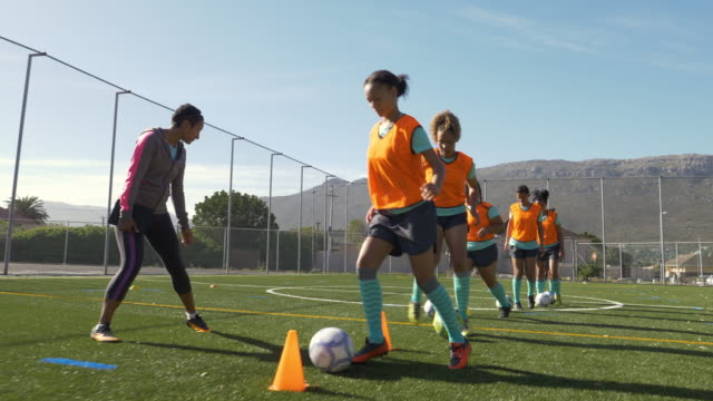 girls soccer team training - warming up stock videos & royalty-free footage