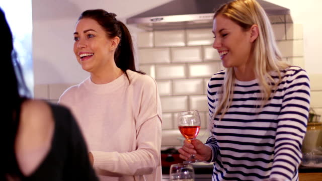 Girls Socialising in the Kitchen