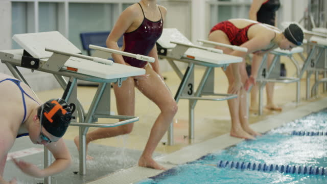 girls splashing water and warming up before swimming race / provo, utah, united states - warming up stock videos and b-roll footage
