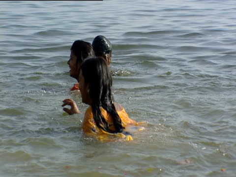 Girls swimming in River Ganges India