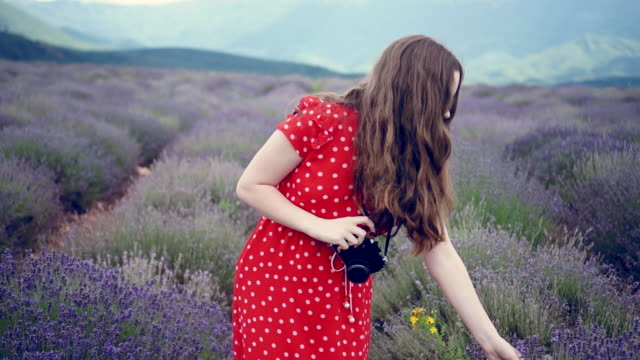 Girls take photos and walk in the lavender field