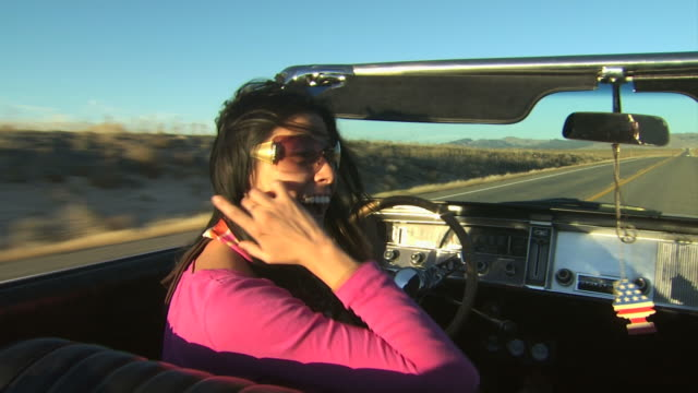 girls talking while riding in a convertible - see other clips from this shoot 1138 stock videos and b-roll footage