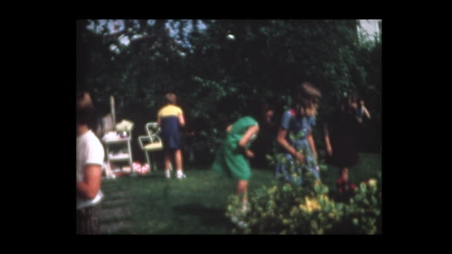 1967 girl's tenth birthday party and treasure hunt - 宝探し点の映像素材/bロール