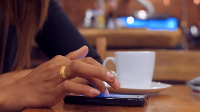 girls using mobile phone and drinking coffee - long distance relationship stock videos & royalty-free footage