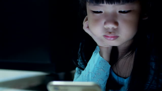 Girls using smartphone at night