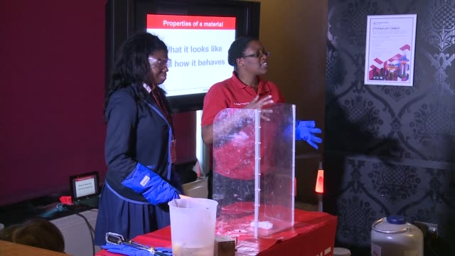 500 girls visit Royal Institution in bid to increase women in STEM jobs London Royal Institution Woman demonstrating science experiment to...