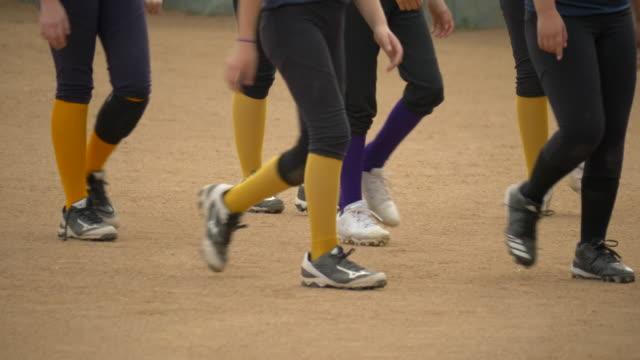 Girls walking after a softball baseball game. - Slow Motion