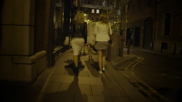 girls walking at night in city from behind - following stock videos & royalty-free footage