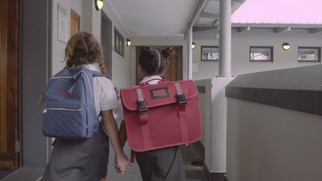 girls walking in corridor of school - backpack stock videos & royalty-free footage