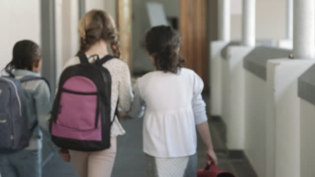 girls walking in corridor while entering classroom - education stock videos & royalty-free footage
