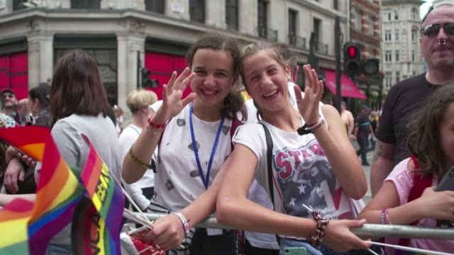 girls wave national crime agency flags atmosphere general views at pride in london 2019 on july 06 2019 in london greater london - child stock videos & royalty-free footage