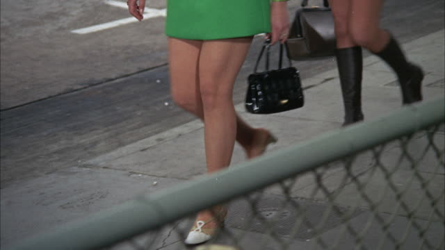 CU POV Girls wearing miniskirts walking on street