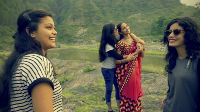 Girls with mother and friend enjoying vacation in hills.