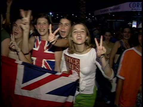 vídeos de stock e filmes b-roll de girls with uk flag and another girl with autographs from backstage - spice girls