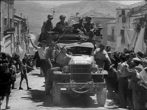 gis on crowded truck driving up village street as crowd cheers / sicily / documentary - 1943 stock videos & royalty-free footage