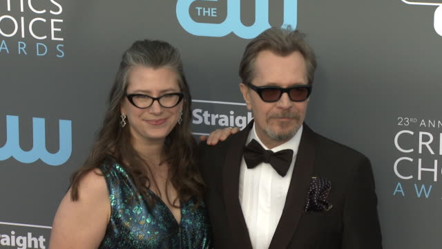 Gisele Schmidt and Gary Oldman at the 23rd Annual Critics' Choice Awards at Barker Hangar on January 11 2018 in Santa Monica California