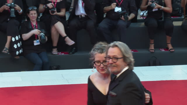 gisele schmidt, gary oldman at 'the laundromat'red carpet arrivals - 76th venice film festival on september 01, 2019 in venice, italy. - gary oldman stock videos & royalty-free footage