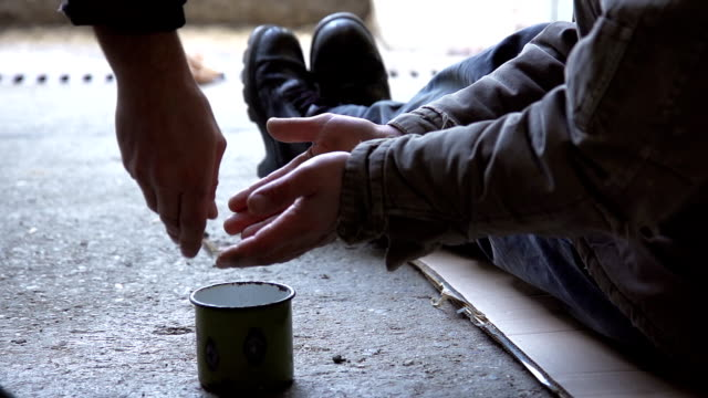hd slow-motion: giving change to a begging homeless - hungry stock videos and b-roll footage
