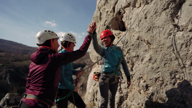 giving high five after a successful climb - safety harness stock videos & royalty-free footage