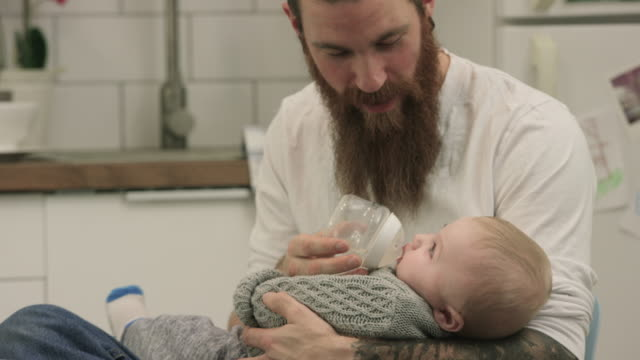 giving his son a bottle - feeding stock videos & royalty-free footage