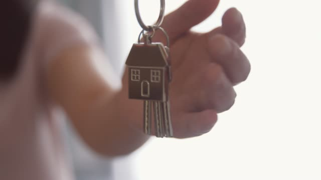 giving keys to new house owner - house key stock videos & royalty-free footage
