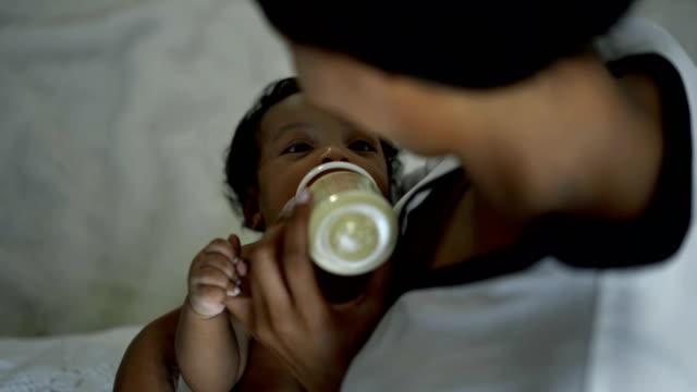 giving milk newborn baby - black woman giving birth stock videos & royalty-free footage