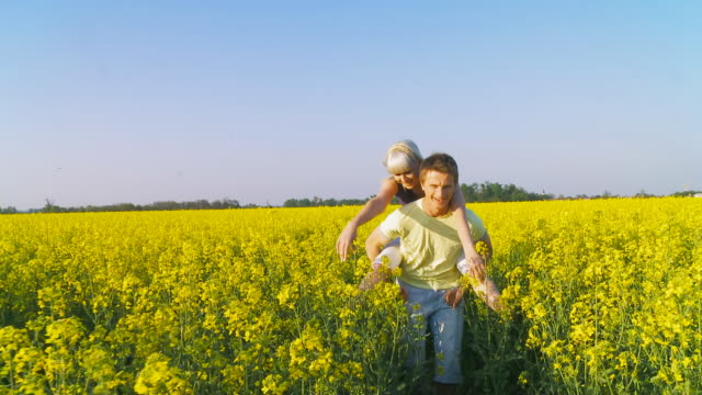 HD: Giving Piggyback In The Canola Field