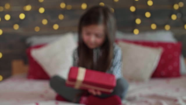 giving the christmas presents/debica/poland - receiving stock videos & royalty-free footage