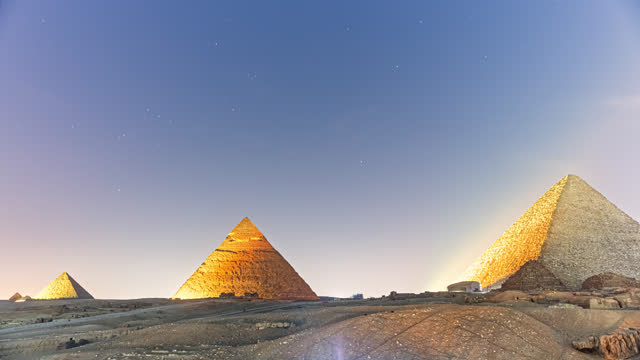 giza pyramids in cairo illuminated with light show in 2021 - day to night transition time-lapse. - temple building stock videos & royalty-free footage