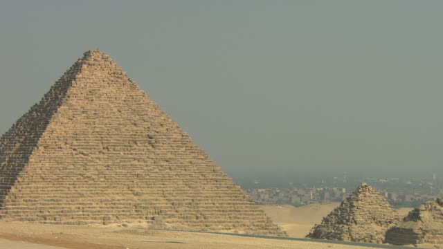 giza pyramids with city in background - pyramid stock videos and b-roll footage