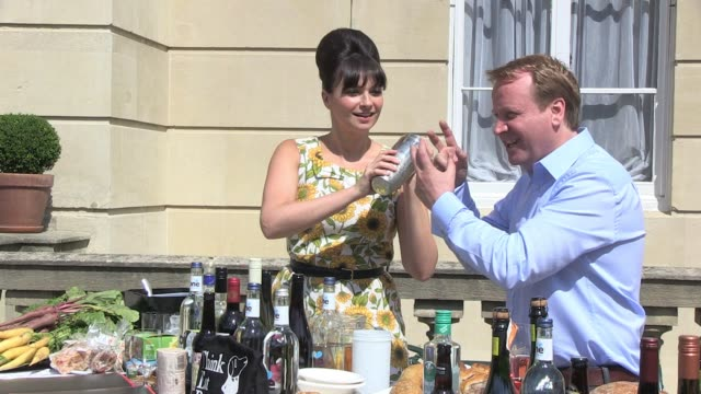Gizzi Erskine Jamie GraingerSmith mix drinks and pose for photos to promote the popup restaurant which will be opening in the opulent surroundings of...