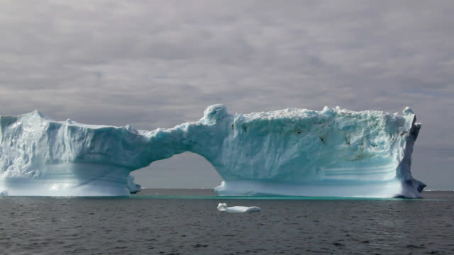 """glacial iceberg, greenland"" - natural arch stock videos & royalty-free footage"