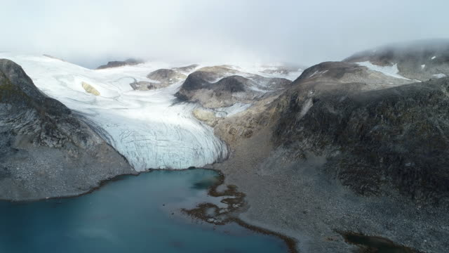 glacial landscape, moody aerial of svalbard - atmospheric mood stock videos & royalty-free footage