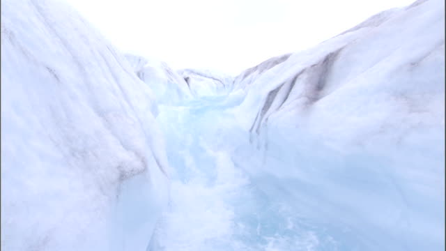 glacial runoff swirls and churns. available in hd. - melting stock videos & royalty-free footage