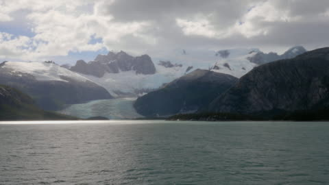 glacier and darwin mountains landscape in chile from a tourist cruise ship - dramatic landscape stock videos & royalty-free footage