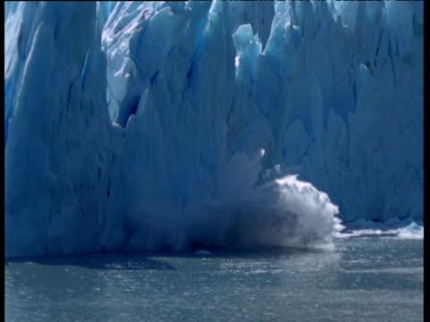 Glacier calves into frozen sea