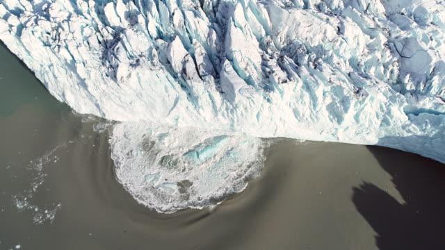 glacier calving splash, aerial view - glacier stock videos & royalty-free footage